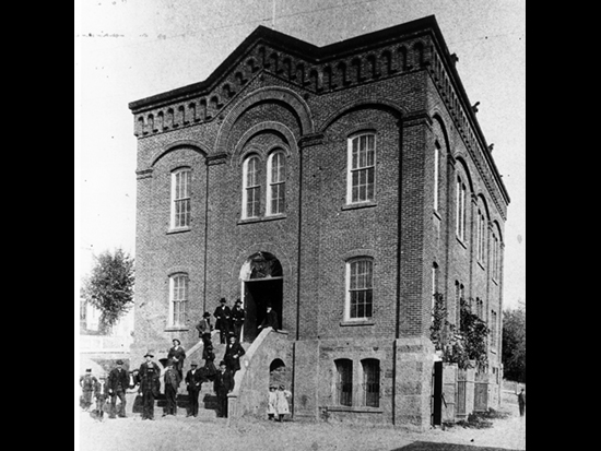 Completed 1864. After an 1862 fire destroyed the county's first courthouse as well as many of the buildings in downtown Jackson, a stone-and-brick courthouse was constructed on the original site. In 1893, a building similar in size and design was constructed next to the courthouse for use as the Hall of Records. An alley separated the two buildings until 1939, when both buildings were enclosed in an art deco exterior. The combined building is still in use as Amador's courthouse. Courtesy Amador County Archives