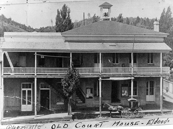 Completed 1861. After several unsuccessful electoral efforts to move the county seat from Coloma to their town, citizens of Placerville in 1857 successfully lobbied the state Legislature to order the move. This two-story building was constructed in Placerville, which prior to 1853 was known as Hangtown because of its reputation for lynchings. The building and its additions burned in 1910, and a new concrete-and-steel courthouse was built on the site. Courtesy El Dorado County Museum