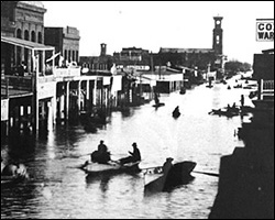 K Street in Sacramento, 1862, rowing east.