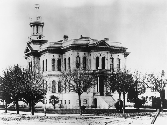 Completed 1888. San Benito's third courthouse was a lavishly decorated building with an exterior modeled on the Farnese Palace in Rome and elaborate balustrades of polished red cedar within. The Hollister landmark withstood many earthquakes but was structurally damaged in a 1961 quake. The courts were moved into a quickly remodeled library while a new courthouse was constructed. The old courthouse was razed the following year. Courtesy Harry Callum, Hollister