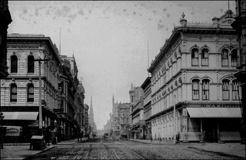 Post Street, looking west from Kearny Street to Grant Avenue (1883-1890) The Court was located in the left (south) block, number 121, in the building immediately below the 'Frey's Music Store' sign.