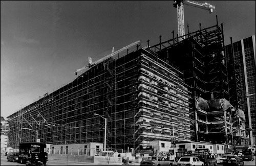 350 McAllister Street (Earl Warren Building), State Building Complex. Construction of the Hiram Johnson component (455 Golden Gate Avenue) of the State Building complex is shown in the background.