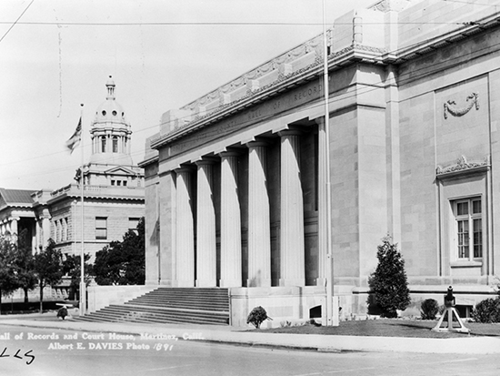 Completed 1931. Built in part by inmate chain gangs from 1901 to 1903 and now a National Historic Site, the old Contra Costa County Courthouse (left) remains in use as the county's Finance Building. The cupola, used as a watchtower during blackouts in World War II, was removed in 1957 for reasons of earthquake safety. In 1966, most of the courts' offices moved into the Hall of Records (right), which was completed in 1933 and continues to serve as the county's courthouse. Both buildings are listed on the National Register of Historic Places. Courtesy Superior Court of California, County of Contra Costa