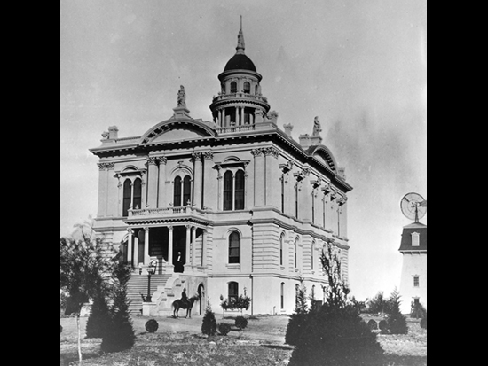 Completed 1875. Merced's first court hearings took place under a tree on a local ranch that had been designated the county seat after the county separated from Mariposa in 1855. Construction was begun in 1874 on this grand Italianate building designed by Albert A. Bennett, one of the architects of the State Capitol Building in Sacramento. The courthouse is adorned with three statues of Justice and topped by a statue of Minerva, the Roman goddess of wisdom. It was used as the county courthouse until 1950, when the courts moved to more modern offices. Renovation of the building began in 1975, and the courthouse was rededicated as a museum in 1983. It is listed on the National Register of Historic Places. Courtesy Merced County Courthouse Museum
