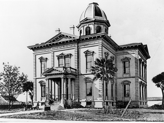 Completed 1878. The military and social capital of Alta California during Spanish and Mexican rule, the town of Monterey naturally became the county seat when the 27 original counties were formed in 1850. But when it was learned that the railroad was to go through the valley and not along the coast, the government center was moved to Salinas. After the house used as a courthouse burned, this much larger brick Victorian building was commissioned. The courthouse remained in use while the current one was being constructed around it, and then was demolished. Today, a courtyard, lily pond, and commemorative sculpture occupy the site. Courtesy California Historical Society