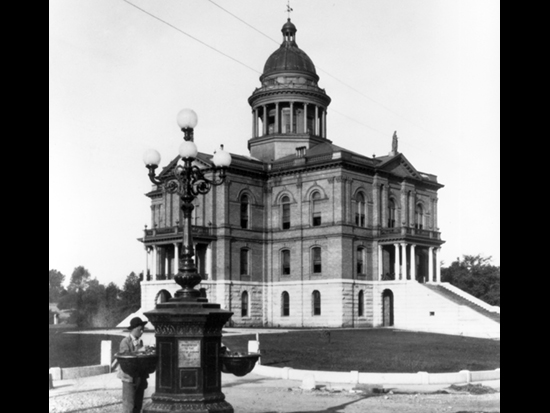"Completed 1898. Once facing an uncertain future, this California landmark was restored in the 1980s and now houses the superior courts, jury rooms, judges' chambers, and court offices. A popular feature of the Auburn courthouse since 1908 is the Neff Fountain, a 15-foot-high water fountain that, according to one local historian, provided ""a place where people, horses, and dogs could drink."" The fountain is now used as a garden centerpiece in front of the courthouse. Courtesy Placer County Historical Society"
