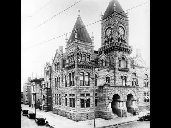 Completed 1898. After supervisors approved a $40,000 tax to construct a new Hall of Records in the late 1880s, south county residents voted to separate from San Bernardino and formed Riverside County in 1893. Undeterred, San Bernardino supervisors approved another tax to finance the construction of this Romanesque Revival building, which was demolished in 1928 after the construction of the current courthouse. The clock in this photo was removed and stored for more than 40 years until it was reinstalled in a new tower a half block from the site of the old courthouse. Courtesy California State Library