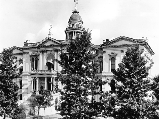 Completed 1876. Tulare's third courthouse, built on the site of the first and second, was considered one of the most beautiful in the state and used as a model for the courthouses in Fresno and Merced Counties. Damage sustained in a 1952 earthquake made the building unsafe, and it was demolished shortly after the courts and county offices found temporary housing in Visalia. The statue of Minerva, the Roman goddess of wisdom, on top of the dome was saved and today greets visitors to the county's historical museum. Courtesy California State Library